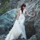 Spring 2014 Alejandra Fit and Flare gown with built-in corset made with silk duchess and Chantilly lace accented with re-embroidered Alençon lace and grosgrain ribbon. Featuring skirt made of cascading silk-organza ruffles.
