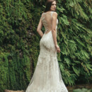 Bristol Ivory Alençon lace gown with a beaded lace illusion back. Mink crepe back satin provides a lightweight and slim fit, with a sheer tulle circle skirt with horsehair and large scallop for a dramatic skirt without the weight.