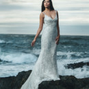 Basilia Slim mermaid gown made from silk crepe back satin. A re-embroidered French Chantilly lace overlay with a corded lace scallop hem compliment the sheer beaded lace panels. Delicate strands of silver beads create a shimmering cowl effect over the open back.