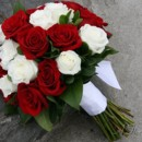 130x130 sq 1393678324965 bb0557 red and white rose hand tied bouque