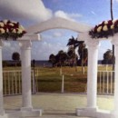 130x130 sq 1484604724014 roman arch with flowers