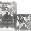 The FLUTTER metal invitation… two butterflies flutter about leafy vines to create this serene invitation. Mails flat and is folded into a sculpture by guests. Folding the wings and curling the leaves will bring depth to the invitation. Place a tea light behind the sculpture and watch the shadows dance! FLUTTER is also available as a favor with slits into which an escort card can be inserted.