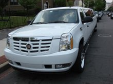220x220_1204336250862-escalade_front_side
