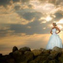 130x130 sq 1381878525611 bride on rocks at sunset close 2