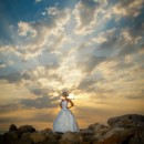 130x130 sq 1381878529802 bride on rocks at sunset close