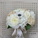 130x130 sq 1381879274119 brides bouquet on chair