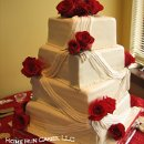 Twisted squares with fondant draping and red roses!