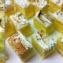 130x130 sq 1295981617917 passionfruitcoconutmousselayeredcakewithswissmeringue