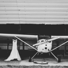 220x220 sq 1502483339126 wedding dress on airplane