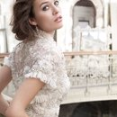 <b>Style:LZ3204</b> <br /> Ivory Baroque inspired vintage lace net bridal gown, strapless sweetheart neckline, sheer alencon lace bodice with beaded and embroidered overlay, soft A-line lace net skirt accented with pleated ruffled godets on side and back of skirt, chapel train. Shown with matching beaded and embroidered bolero net jacket accented with pleated tulle trim (204J).