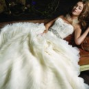 Style:LZ3100 Ivory organza wave bridal ball gown, sheer alencon lace bodice with organza petal accent, platinum jeweled ribbon belt at natural waist, circular skirt, chapel train.