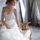 Style: LZ3161Ivory floral organza bridal ball gown, strapless sweetheart neckline, sheer corseted jewel encrusted bodice, floral organza A-Line skirt with crystal accent, chapel train.