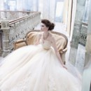 Style:LZ3251 Buttercup tulle ball gown, sweetheart neckline, sheer corseted Alencon lace bodice, gold silk ribbon at natural waist, circular box pleated tulle skirt accented with Alencon lace applique, chapel train