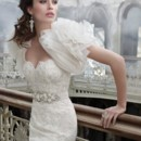 Style:LZ3201 Ivory lace organza wave bridal gown, strapless sweetheart neckline, corseted sheer alencon lace elongated bodice, silver moiré jeweled ribbon belt at natural waist, asymmetrical organza wave skirt, chapel train. Shown with organza wave bolero jacket (201J).