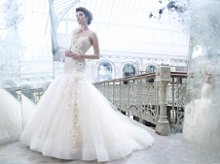 <b>Style:LZ3259</b> <br /> Sherbet tulle bridal ball gown, sweetheart neckline, sheer elongated Alencon lace corseted bodice, silk chiffon flowers with crystal centers accent one shoulder cascading down bodice onto gathered tulle skirt, chapel train