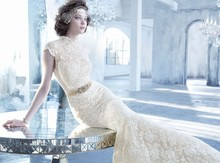 Style LZ3352 Ivory/Gold alencon lace trumpet bridal gown with cashmere chiffon underlay, mandarin collar neckline, keyhole back, Maria Elena floral crystal belt at natural waist, circular skirt, chapel train. Available in Ivory Gold or Ivory Belt available in Gold or Silver