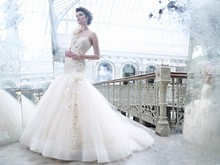 Style:LZ3259 Sherbet tulle bridal ball gown, sweetheart neckline, sheer elongated Alencon lace corseted bodice, silk chiffon flowers with crystal centers accent one shoulder cascading down bodice onto gathered tulle skirt, chapel train
