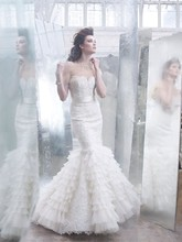 Style:LZ3258 Ivory Alencon lace pleated silk organza trumpet gown, sweetheart neckline, sheer corseted lace bodice, silk ribbon at natural waist, trumpet skirt with pleated silk organza godets, chapel train