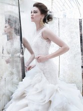 Style:LZ3253 Ivory organza flounce bridal ball gown, sweetheart neckline with jewel neck tulle overlay, sheer corseted Alencon lace elongated bodice, layered asymmetrical organza skirt, chapel train
