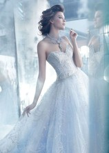Style LZ3320 Wisteria tulle ball bridal gown with hand embroidered silver overlay, sweetheart neckline, sheer embroidered bodice, dropped waist, full gathered skirt, sweep train.