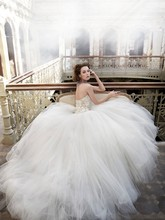 Style:LZ3209 Ivory tulle bridal ball gown, sweetheart neckline, beaded and embroidered bodice with silk chiffon flower accents, dropped waist, circular tulle skirt, chapel train.