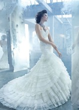 Style LZ3308 Flamenco inspired ivory organza and alencon lace bridal gown, sheer elongated lace bodice, sweetheart neckline, layered organza and lace skirt, chapel train.