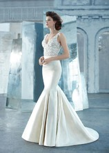 Style LZ3314 Antique silk faced satin trumpet bridal gown, sheer jewel encrusted V-neck bodice, crystal trim at natural waist, chapel train.
