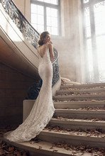 3501  Ivory/Silver alencon lace trumpet bridal gown, V-neckline with beaded necklace at back, jeweled appliques at natural waist, chapel train.