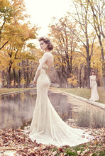 3512  Ivory/Gold chantilly lace trumpet bridal gown, corseted lace bodice with golden jewel filigree at natural waist, sweetheart neckline, fitted lace sleeves, keyhole back, chapel train.