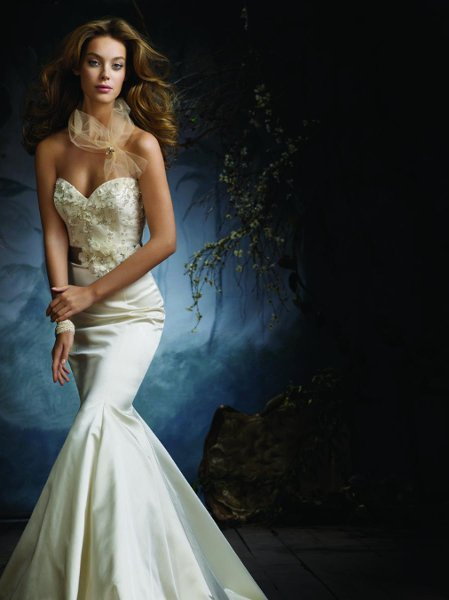 Style:LZ3105 Ivory silk faced satin trumpet bridal gown, hand beaded and embroidered tulle bodice with silver accents, sweetheart neckline, platinum silk satin ribbon belt with hand-made flowers at natural waist, trumpet skirt, chapel train.