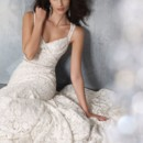 Style 1104 Ivory Cotton lace over Champagne Charmeuse modified A-line bridal gown, sweetheart neckline, softly draped bodice, natural waist accented with crystal ribbon trim, open sheer back, sweep train.