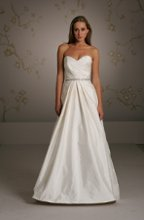 Style 1054 Ivory Tissue Taffeta bridal ball gown, strapless draped bodice with sweetheart neckline, natural waist accented with crystal beaded band on satin ribbon, inverted pleated skirt, side pockets, sweep train.