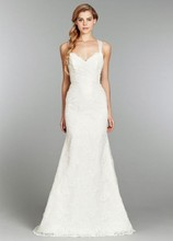 Clementine, Style 1351 Ivory slim lace bridal gown with english net straps and ruched detailing on bodice tying into a bow on the back and chapel train