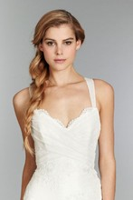 Clementime, Style 1351 <br /> Ivory slim lace bridal gown with english net straps and ruched detailing on bodice tying into a bow on the back and chapel train.