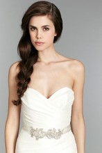 Daffodil, Style 1353 Ivory strapless fit to flare dupioni bridal gown with ruched bodice, beaded sash at waist, cascading horsehair ruffle detailing on chapel train