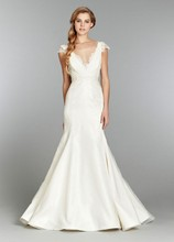 May, Style 1357 Ivory fit to flare organza bridal gown, ruched V neckline with lace peek-a-boo, dainty lace capsleeves, and lace keyhole back with chapel train.