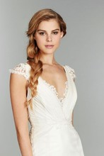 May, Style 1357 <br /> Ivory fit to flare organza bridal gown, ruched V neckline with lace peek-a-boo, dainty lace capsleeves, and lace keyhole back with chapel train.