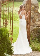 Jim Hjelm Blush  1351  Ivory slim lace bridal gown with english net straps and ruched detailing on bodice tying into a bow on the back and chapel train