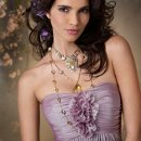 Style jh5080 Lavender luminescent chiffon strapless baby doll bridesmaid gown, gathered empire bodice with flower detail.