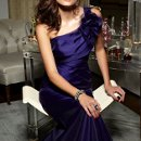 Style JH5245  <br /> Grape organza A-line bridesmaid gown, one-shoulder neckline with flower detail, asymmetrical pleated bodice, dropped waist.  <br /> Available Colors: Black, Espresso, Ivory, Navy, Taupe, Wine, Graphite, Garnet, Grape, Camel.