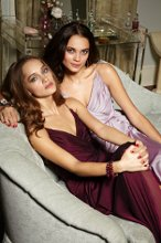 Style JH5228  Merlot luminescent chiffon A-line bridesmaid gown, V-neckline, draped bodice.  Available Colors: Black, Blush, Bordeaux, Burgundy, Candlelight, Caribbean, Cashmere, Cornflower, Eggplant, Indigo, Ivory, Melon, Mocha, Moss, Papaya, Raspberry, Rose, Sage, Silver, Teal, Violet, White, Mink, Ice Blue, Frosted Violet, Fuchsia, Azalea, Cobalt, Candy Apple, Buttercup, Ballet, Charcoal, Chocolate, Emerald, Lavender, Plum, Ruby, Shimmer, Tahitian, Canary, Jasper, Stone, Coral, Noir, Royal, Merlot, French Blue.