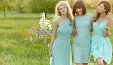 From Right: Style JH5375 Mint crinkle chiffon A-line bridesmaid dress, draped V-neck bodice, natural waist, ruffle cascade skirt detail. <br /> Style JH5373  <br />Celadon textured linen sheath bridesmaid dress, bateau neckline with natural waist, pockets at side. <br /> Style JH5374  <br /> Ice blue chiffon A-line bridesmaid dress, one shoulder neckline with asymmetrically draped waistband, soft gathered skirt. Available in stores mid-summer 2013.