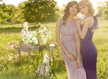 Style JH5365 Plum luminescent chiffon A- Line bridesmaid gown, sheer illusion halter neckline with gathered band at natural waist, soft gathered skirt, criss-cross back with bow detail.