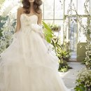 StyleTK2202 Ivory tulle bridal ball gown, strapless sweetheart neckline with flower appliques on bodice, dropped waist, spiral skirt with horsehair trim and chapel train.