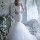 Style TK2301 Ivory Chantilly lace fit and flare bridal gown, sleeveless elongated bodice with keyhole back and horsehair sash, tiered tulle skirt with Chantilly lace accent. Chapel train.