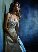 Style tk2152  <br /> Ivory Mikado bridal ball gown. Draped sweetheart bodice, crystal belt at natural waist. Ballgown skirt with box pleats, pockets and chapel train. <br /> <br /> Available in Ivory and Natural White