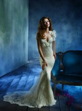 Style tk2157 <br /> Ivory lace trumpet bridal gown with deep sweetheart neckline, floral applique at empire waist and spaghetti straps. Sparkle tulle underlay, chapel train. Lace bolero with floral applique. <br /> <br /> Available in Ivory and White.
