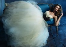 Style: tk2161 Ivory silk organza and tulle bridal ballgown. Strapless sweetheart hand draped silk organza bodice with chapel train. Black organza and horse hair origami belt. Available in Ivory and White. Belt available in Black, Ivory, White, and various colors.