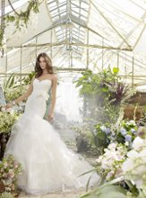 TK 2200 Ivory Alencon lace bridal gown with strapless sweetheart neckline and elongated bodice, horsehair belt at natural waist, three tiered tulle skirt with horsehair trim and chapel train. Available in stores Spring 2012