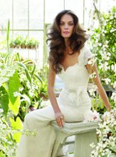 TK2201 Ivory Alencon lace A-line bridal gown with V-neckline, keyhole back and cap sleeves, satin ribbon at natural waist with floral organza appliqué and chapel train. Available in stores Spring 2012